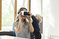 Mother with son wearing Virtual Reality Glasses - SBOF000119