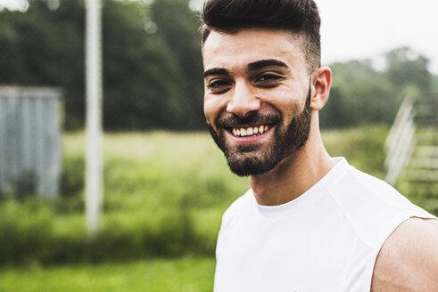 Portrait of smiling athlete outdoors - UUF007697