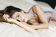 Woman in lingerie lying on bed - SHKF000609