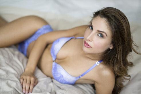 Woman in lingerie lying on bed - SHKF000612