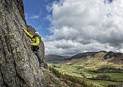 England, Cumbria, Lake District, Langdale, Raven Crag, Middlefell Buttress, climber - ALRF000537