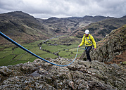 England, Cumbria, Lake District, Langdale, Raven Crag, Middlefell Buttress, climber - ALRF000540
