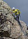 England, Cumbria, Lake District, Langdale, Raven Crag, Middlefell Buttress, climber - ALRF000543
