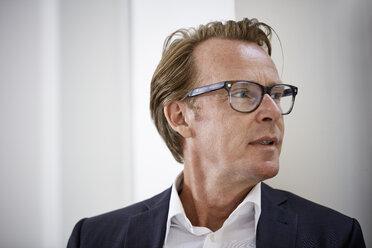 Portrait of businessman wearing glasses - RHF001634