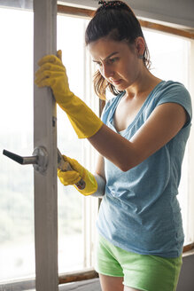 Young woman renovating old window - BZF000303