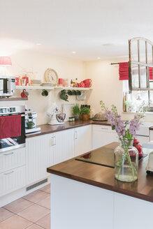Kitchen with flowers on kitchen island - MJF001842
