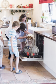 Family and dog in kitchen at dishwasher - MJF001863