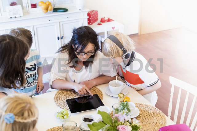 Mother and children sharing digital tablet - MJF001872