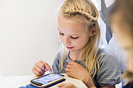 Girl playing on cell phone - MJF001887