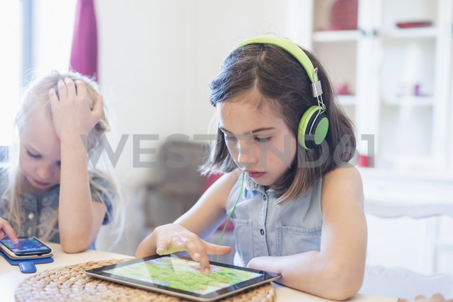 Two girls using mobile devices - MJF001890
