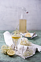 Glass of water flavoured with elderflower sirup and lemon - MYF001530