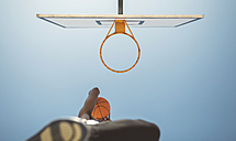Young man aiming at basketball hoop - DAPF000152