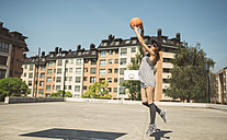 Young woman aiming at basketball hoop - DAPF000155