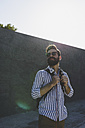 Bearded young man with sunglasses and headphones - FMOF000023
