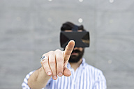 Forefinger of man playing with Virtual Reality Glasses typing in the air - FMOF000026