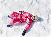 Little girl playing in a snow, lying - MGOF001973