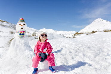 Spain, Asturias, girl in front of a snowman - MGOF001976