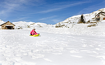 Spain, Asturias, girl with sledge in the snow, sledging - MGOF001979