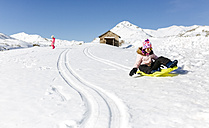 Spain, Asturias, girl with sledge in the snow, sledging - MGOF001985
