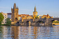 Czechia, Prague, Vltava river, Old town with Charles Bridge with bridge tower, water tower of old mill in the background - WGF000876