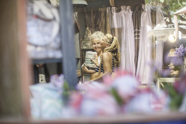 Two women shopping in vintage store - ZEF008777