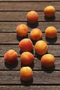 Organic apricots on wood - JTF000754