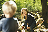 Brother and sister playing in forest - SBOF000134