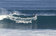 Indonesia, Bali, Surfer on a wave - KNTF000379