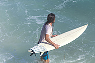 Indonesia, Bali, Surfer in front of a wave - KNTF000382