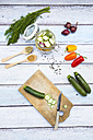 Glass of pickled courgette and bell pepper, preparation with different spices - LVF004989