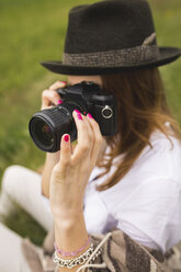 Woman photographing in nature - BOYF000431