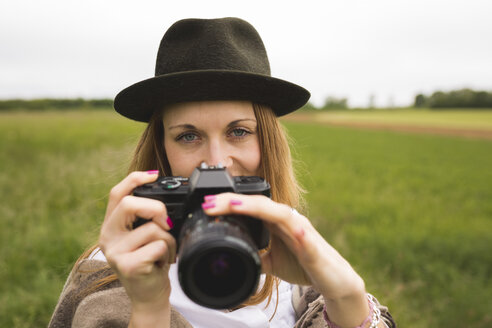 Portrait of woman with camera in nature - BOYF000434
