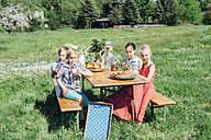 Children at beer table set with fruit and drinks on meadow - MJF001901
