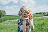 Boy outdoors eating slice of watermelon - MJF001910