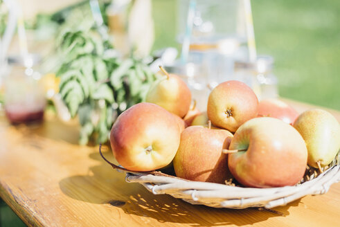 Apples on outdoor table - MJF001928