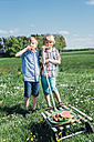 Two boys outdoors eating watermelon - MJF001937