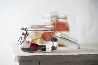 Preserving jar of cooled water flavoured with different fruits - MYF001597