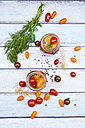 Two glasses of pickled tomatoes - LVF004993