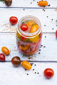 Glass of pickled tomatoes - LVF004996