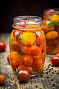 Glass of pickled tomatoes - LVF004999
