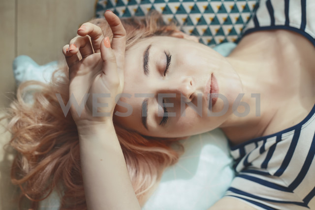 Portrait of young woman with eyes closed - RTBF000239