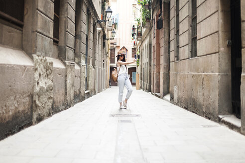 Young tourist discovering streets of Barcelona, taking selfie - VABF000635
