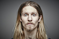 Portrait of starring young man with long blond hair and beard - RHF001657