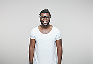 Portrait of laughing man wearing glasses and white t-shirt - RHF001672