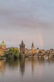 Czech Republic, Prague, Rainbow over Charles Bridge at sunset - MELF000127