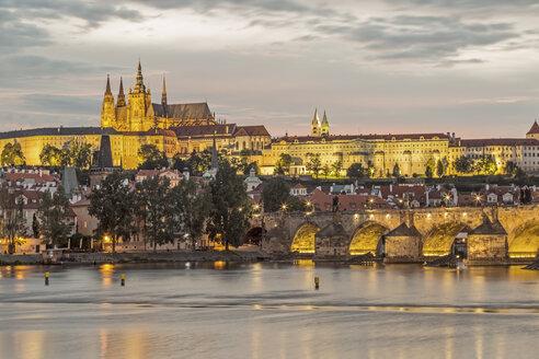 Czechia, Prague, illuminated Prague Castle and Charles Bridge in the evening - MELF000130