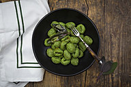 Plate of homemade spinach gnocchi prepared with sage leaves - LVF005026
