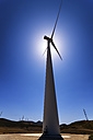 Spain, Andalusia, Wind turbine against the sun - SMAF000505