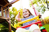 Portrait of happy little girl on a swing - HAPF000558