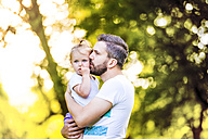 Father holding his little daughter on his arms - HAPF000561